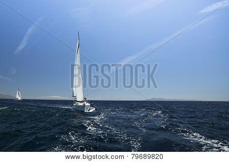 METHANA - POROS - ERMIONI, GREECE - APR 29, 2014: Unidentified sailboats participate in sailing regatta