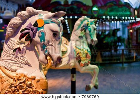 Horses With Carousel In Background