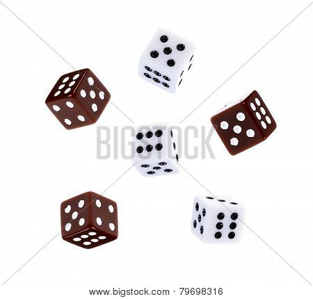 White and colored dice through the Air