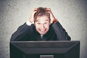 image of fail job  - young man at the computer fails stress depression - JPG