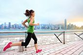 Постер, плакат: City Running woman runner and Hong Kong skyline Female athlete fitness athlete jogging training l