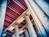 stock photo of greek-architecture  - Retro Style Photo Of Pillars And Red Ceiling Of Grand Greek Or Roman Architecture - JPG