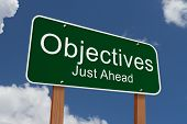 picture of objectives  - Objectives Just Ahead Sign Green highway sign with words Objectives Just Ahead with sky background - JPG