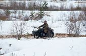 picture of cold-war  - RUSSIA LIZLOVO - DECEMBER 14: Unidentified soldier drive on motorbike on reenactment of the counterattack under the Moscow in 1941 in World War II in Moscow region Lizlovo village Russia 2014 ** Note: Visible grain at 100%, best at smaller sizes - JPG