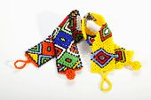 foto of curio  - brightly colored zulu beaded wristbands in shape of aids ribbons - JPG