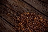 foto of coffee coffee plant  - Coffee on grunge wooden background Fresh coffee beans on wood and linen bag ready to brew delicious coffee - JPG