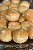 foto of cream puff  - Looking at a glass plate filled with delicious decadent cream puffs - JPG