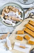 image of toffee  - Sweet caramel toffee caramels on wooden table - JPG