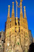 stock photo of gaudi barcelona  - One of the facades of the Sagrada Familia in Barcelona at dawn - JPG