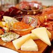 foto of cheese platter  - Cheese and sausage platter with nuts and citrus jam - JPG