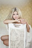 stock photo of nightgown  - Beautiful young blonde with long straight hair - JPG