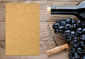 stock photo of wine grapes  - Bottle of wine corkscrew grape and blank paper - JPG