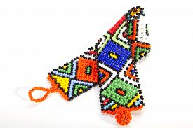 stock photo of zulu  - multicolored zulu beaded wristband twisted in shape of aids symbol - JPG