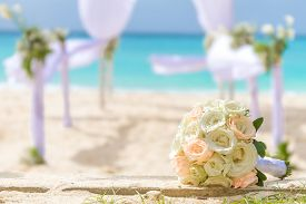 pic of marriage ceremony  - beautiful bridal bouquet on wedding arch background - JPG