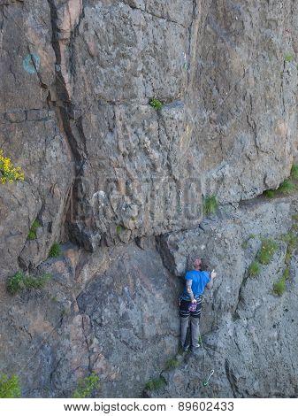 Man Climbing Wall.
