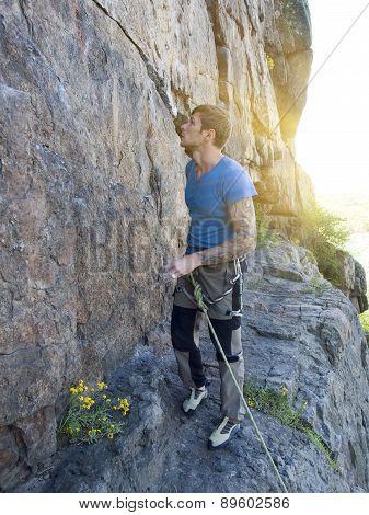 The man climbs the wall.