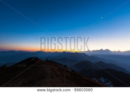 Twilight On Cattle Back Mountain With Moon In The Sky