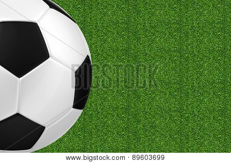 Soccer Ball Over Green Grass Background