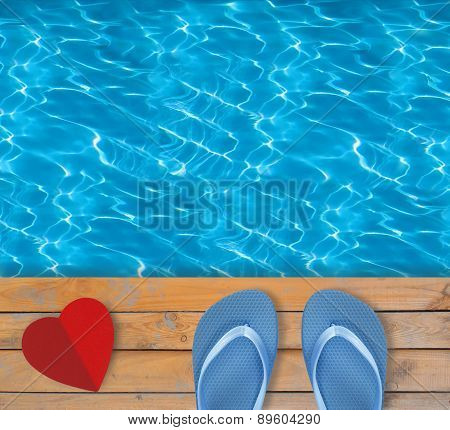 Swimming Pool With Blue Clear Water, Wooden Deck And Red Paper Heart
