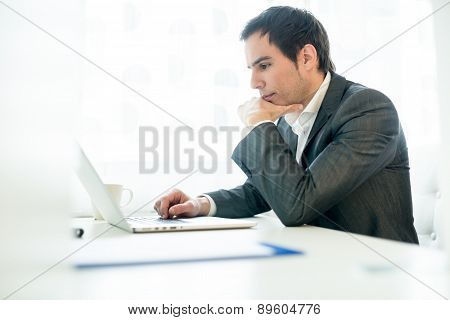 Serious Young Businessman Concentrating On His Work