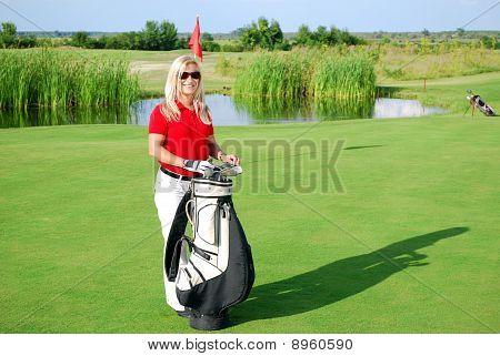 girl posing on golf field