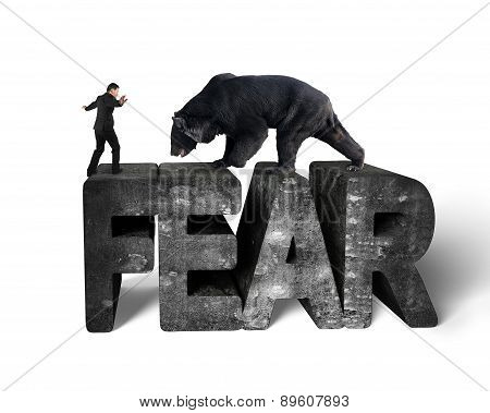 Businessman Against Black Bear Balancing On 3D Fear Concrete Word
