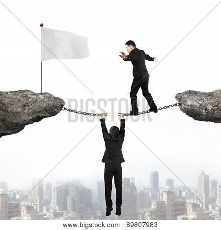 Businessman Balancing On Cracking Chain Another Man Holding Toward Flag