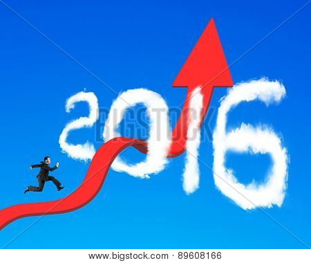 Businessman Running On Arrow Upward Trend Line Through 2016 Clouds
