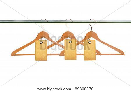 Wooden Clothes Hangers With Blank Tags Isolated On White