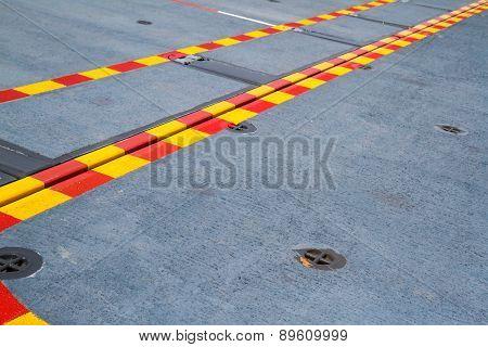 Red Yellow Line On The Steel Floor.