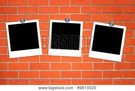 Blank Old Photos On Clips On Brick Wall Background