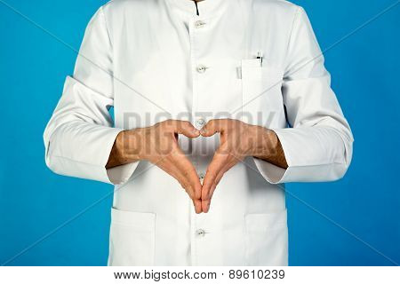 Close up of doctor's hands making heart