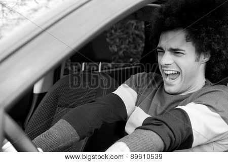 Black And White Portrait Of Man Getting Into Accident With Car