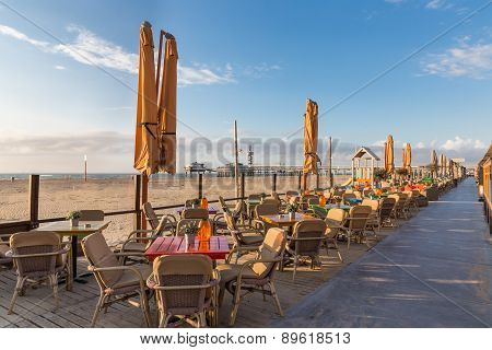 Terraces Along The Dutch Beach With A View At The Pier Of Scheveningen