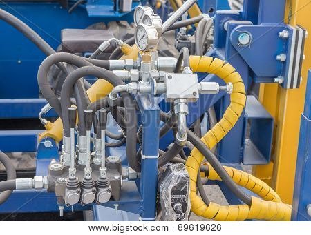 Hydraulic tubes, fittings and levers on control panel