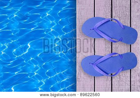 Swimming Pool, Wooden Deck And Blue Beach Shoes