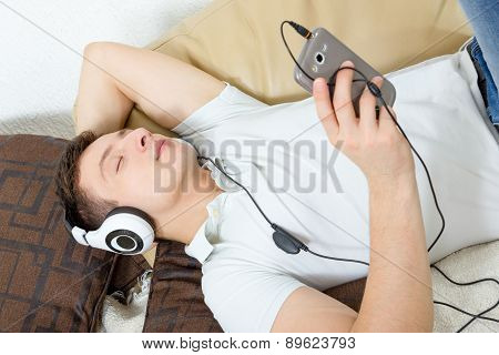 Man Fall Asleep Listening To Music Over Smartphone With Headphones