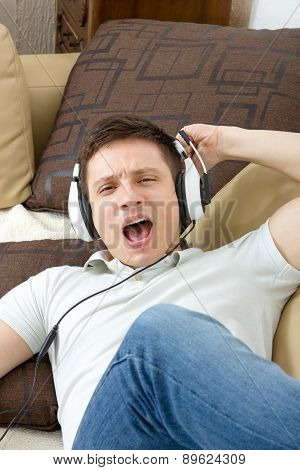 Man Singing Listening To Music Over Headphones Enjoying