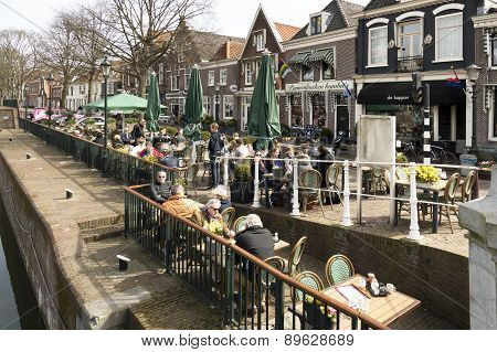 NETHERLANDS - MUIDEN - CIRCA APRIL 2015: People on a terrace in the center of Muiden.