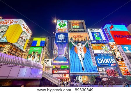 OSAKA - NOVEMBER 25, 2012: The famed advertisements of Dotonbori at night. With a history reaching back to 1612, the district is now one of Osaka's primary tourist destinations.