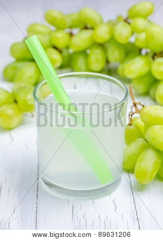 Glass Of White Grapes Juice And Grapes On Background