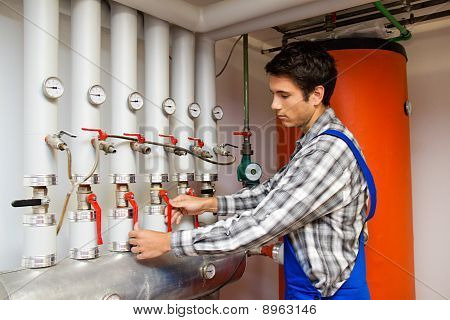 Heating Engineer In A Boiler Room For Heating System