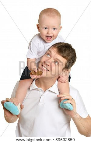 father and a young child on a white