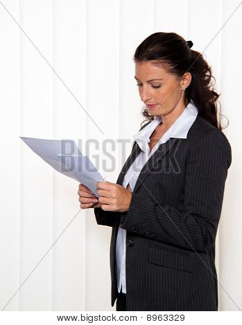 Businesswoman Reading A Letter