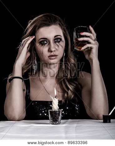 Depressed Young Woman With A Glass Of Whiskey
