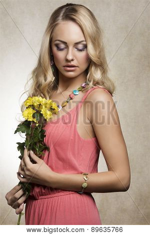 Cute Girl In Pink Spring Dress With Flowers