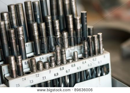 Set Of Drill Bits In A Workshop