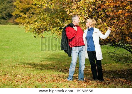 Mature couple having a walk