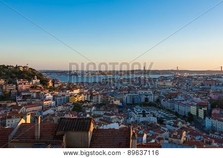 Aerial View Of Lisbon Rooftop From Senhora Do Monte Viewpoint (miradouro)  At Dusk In Portugal