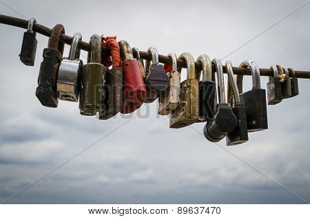 Assorted Steel Locked Padlocks And Cloudy Sky